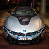 BERLIN - NOVEMBER 28, 2014: Showroom. The BMW i8, first introduced as the BMW Concept Vision Efficient Dynamics, is a plug-in hybrid sports car developed by BMW — Stock Photo