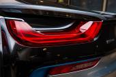BERLIN - NOVEMBER 28, 2014: Showroom. The rear lights of the car BMW i8, first introduced as the BMW Concept Vision Efficient Dynamics, is a plug-in hybrid sports car developed by BMW. — Stock Photo