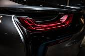 BERLIN - NOVEMBER 28, 2014: Showroom. The rear lights of the car BMW i8, first introduced as the BMW Concept Vision Efficient Dynamics, is a plug-in hybrid sports car developed by BMW. Toning — Stock Photo