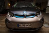 BERLIN - NOVEMBER 28, 2014: Showroom. The BMW i3, previously Mega City Vehicle (MCV), is a five-door urban electric car developed by the German manufacturer BMW. — Stock Photo