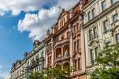 The beautiful facade of the old building. Stylization. Toning. Prague is the capital and largest city of the Czech Republic. — Stock Photo