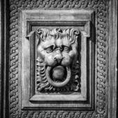 Woodcarving. Decoration vintage gate of the Old Town Hall. Prague. Black and white. Vignetting. Stylization. — Stock Photo