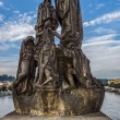 Sculpture of Saint Cyril and Saint Methodius on the Charles Bridge in Prague. Czech Republic. Stylization — Stock Photo #61597617