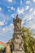 Sculpture of Saint Adalbert on the Charles Bridge in Prague. Czech Republic. — Stockfoto