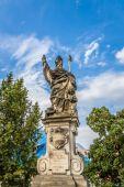 Sculpture of Saint Augustine on the Charles Bridge in Prague. Czech Republic. — Stock Photo