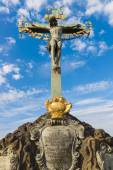 Sculpture (Crucifix and Calvary) on the Charles Bridge in Prague. Czech Republic. — Stock Photo