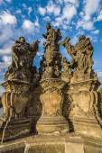 Sculpture of Madonna, Saint Dominic and Saint Thomas Aquinas on the Charles Bridge in Prague. Czech Republic. — Stock Photo