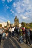 Tourists on the Charles Bridge. The Charles Bridge is a famous historic bridge that crosses the Vltava river in Prague. — Stock Photo