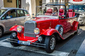 Tour of the city on an old car. Prague is the capital and largest city of the Czech Republic. — Stock Photo