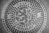 Manhole cover of sewage wells. Black and white. Prague is the capital and largest city of the Czech Republic. — Foto Stock