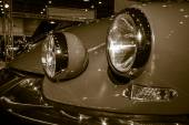 Headlamp of a mid-size luxury car Citroen DS21 Break. Stylization. Sepia — Stock Photo