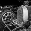 Постер, плакат: Racing Cars Bugatti Type 35 37 54 standing in a row Black and white