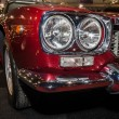 Постер, плакат: Headlamp of a sports car Maserati Mexico 4 2 Tipo AM112 1972