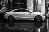 Showroom. Compact executive car Mercedes-Benz CLA200. Black and white. Produced since 2013. — Stock Photo
