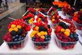 Sale of fresh berries. Focus on the foreground. — Stock Photo