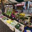 Sales of fresh flowers in the market square in the historic center. — Stock Photo #69355233