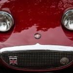 Постер, плакат: Fragment of a sports car Austin Healey Sprite Mk I
