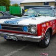 Постер, плакат: Muscle car Plymouth GTX in the racing coloring