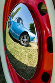 Reflections of an old car in the decorative wheel covers. — Stock Photo