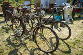 Old and rusty bikes at the flea market. — Stock Photo
