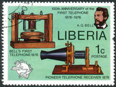 Postage stamp printed in Liberia, is devoted to Cent. of 1st telephone call by Alexander Graham Bell, shows AG Bell, Telephone and Receiver, UPU Emblem — Stock Photo