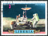 Postage stamp printed in Liberia, dedicated to Apollo 16 US moon mission, shows Astronaut and Lunar Rover — Stock Photo