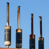 Exhaust pipes against the sky. — Stock Photo