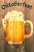 Oktoberfest banner on old wooden texture — Stock Photo