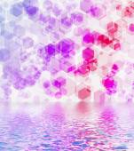 Hexagon bokeh reflected in water. — Stock Photo