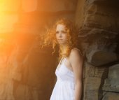 Redhead woman in a white dress. — Stock Photo