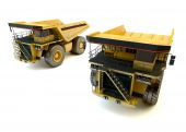Two dumper industrial trucks isolated at the white background  — Stockfoto