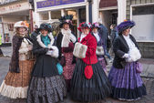 ROCHESTER, UK-DECEMBER 6: People dressed in fine Victorian costumes parade in the streets in the annual Rochester Dickensian Christmas Festival, December 6, 2014, Rochester UK. — Stock Photo