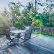 Beach house porch at sunrise — Stock Photo #51882625