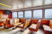 ferry boat cabin and rows of seats looking out the window — Stock Photo