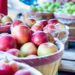Large bushel basket full of fresh locally grown red apples at lo — Stock Photo #56053117