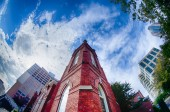 Old brick church abuilding in a city — ストック写真