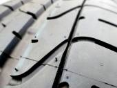 Tire tread closeup in a tire shop — Stockfoto