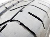 Tire tread closeup in a tire shop — Stock Photo