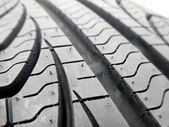 Tire tread closeup in a tire shop — Stock Photo