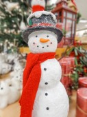 Christmas snowman in a hat and scarf — Stock Photo