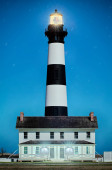Black and white striped lighthouse at Bodie Island on the outer  — Stock Photo