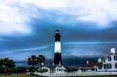 Tybee island beach lighthouse with thunder and lightning — Stock Photo