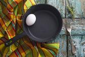 Iron pan with egg — Stock Photo