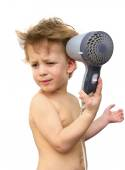 Baby boy with hair dryer over white — Stock Photo