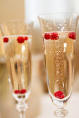 Two glasses of Champagne on a table — Stock Photo