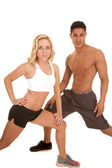 Couple stretch both lunge looking — Stock Photo