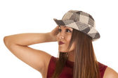 Woman in plaid hat — Stock Photo
