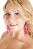 Woman in lighting bolt earrings. — Stock Photo