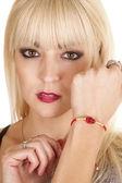 Woman with bracelet lady bug — Stock Photo