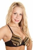 Woman in bra with gold spikes — Stock Photo